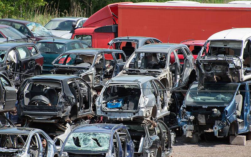 pile of scrap cars at yard